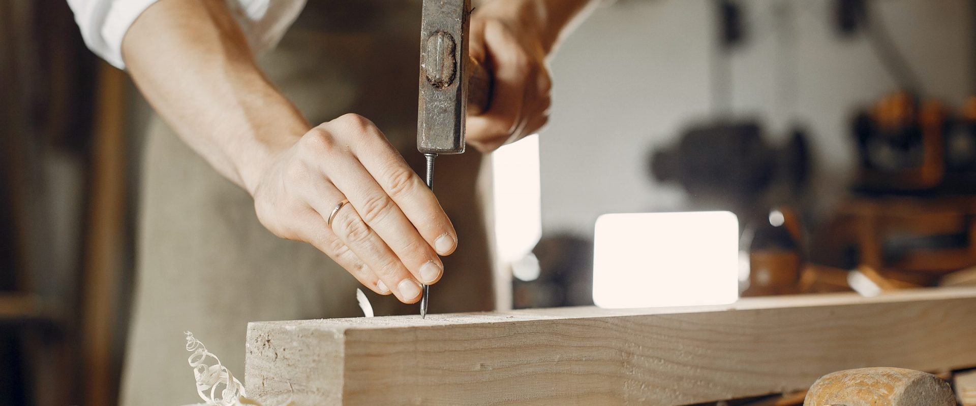 hammering nails into the wood